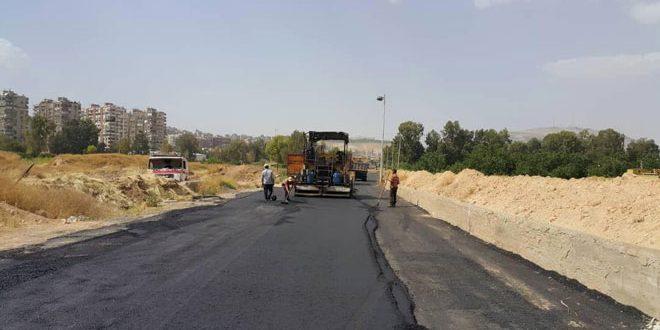 أعمال تزفيت طريق نهر عيشة ومدخل داريا على المتحلق الجنوبي بدمشق